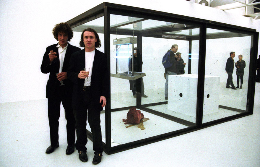 damian-hirst-with-vitrines-saatchi-gallery-1992-880
